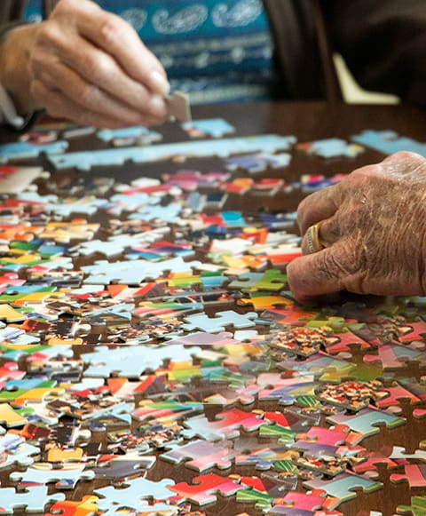 seniors putting a puzzle together