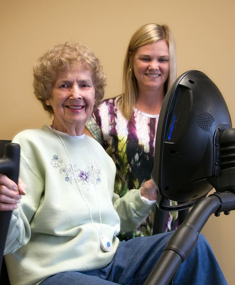 resident doing therapy with pt machine