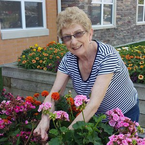 active senior woman gardening