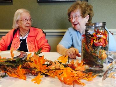 senior women laughing and eating