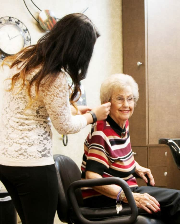 senior woman getting salon and spa services