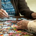 Residents in Memory Care Doing a Puzzle