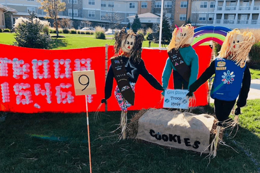Gut troop scarecrows sell cookies at Residences irl Scoat Deer Creek