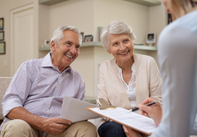 Two seniors looking at Medicare options together